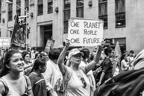 Monochrome image of woman carrying a placard at PCM, NY stock photo