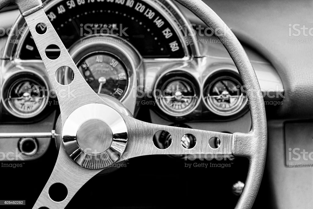 Monochrome image steering wheel and interior of a classic car. stock photo