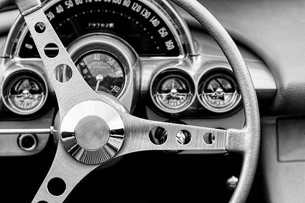 monochrome image steering wheel and interior of a classic car. - oldtimer veranstaltungen stock-fotos und bilder
