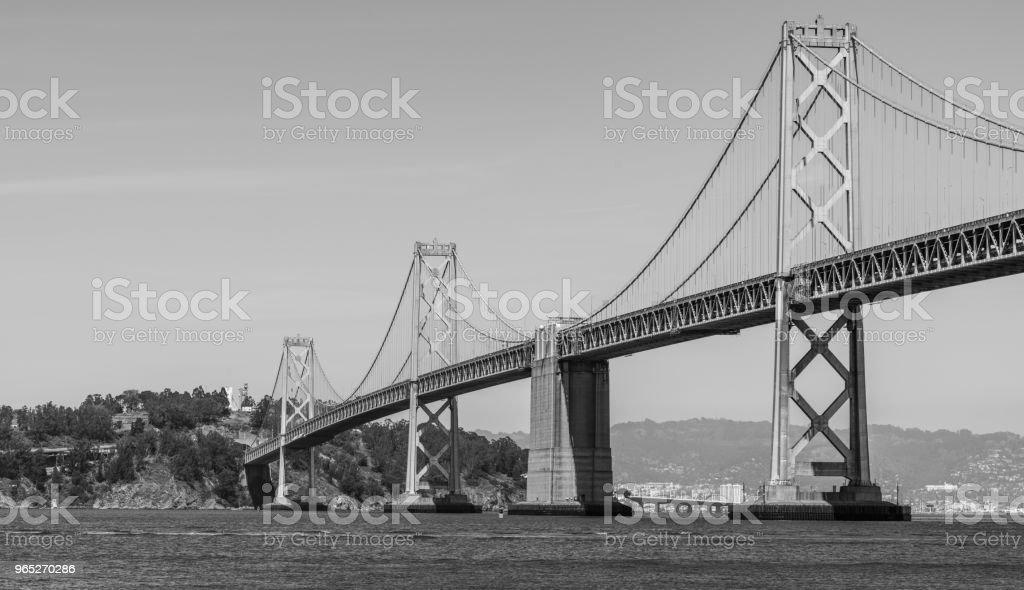 Monochrome Oakland Bay Bridge to San Francisco , California Suspension bridge over the Bay Area black and white royalty-free stock photo
