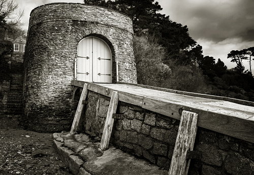Monochrome of Old boathouse on Helford River, Falmouth Cornwall