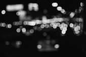Defocus blurred heavy city traffic lights black and white background concept