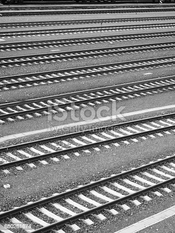 Monochrome outdoor photo of railway tracks on station no people
