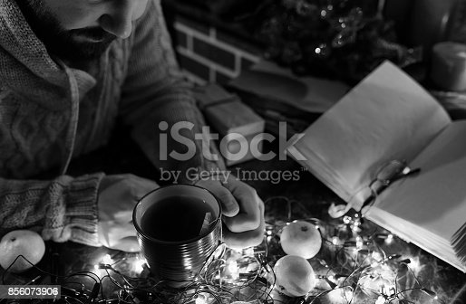 1069359694 istock photo monochrome photo of man with a blank book in his hands for the N 856073906
