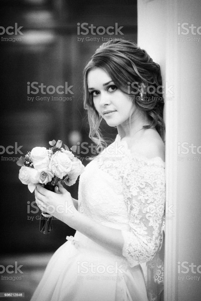 monochrome Portrait of the bride against the wall stock photo