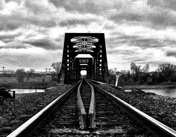 monochrome railroad tracks black and white missouri river train tressle - montana samuel howell stock pictures, royalty-free photos & images