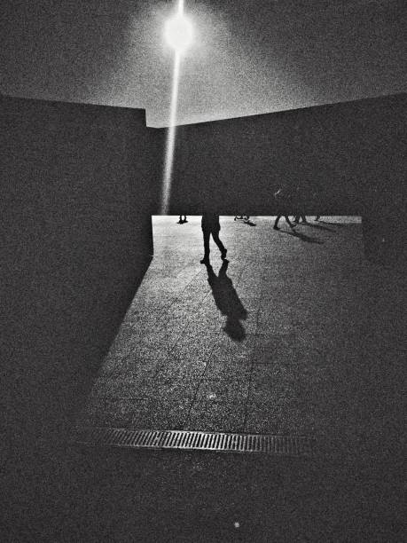 Monochrome view of the people walking in shopping mall