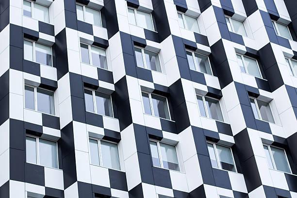 Monochromic cubic minimalistic bauhaus office building facade of business center - Photo