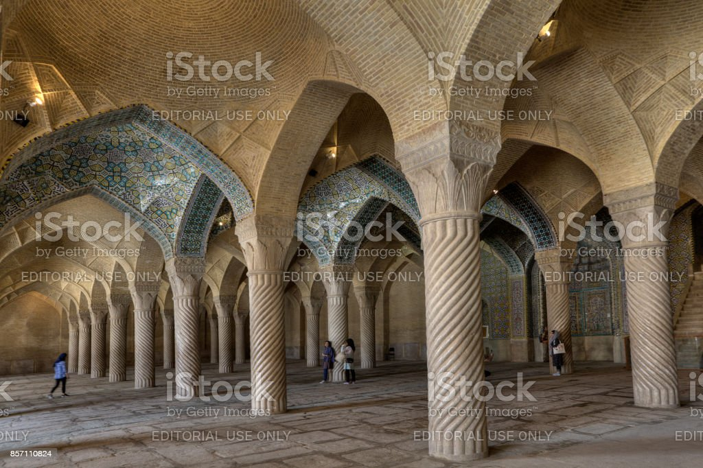 Monolithic pillars support arched vaults in Vakil Mosque, Shiraz, Iran. stock photo