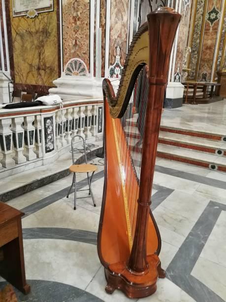 Monopoli - Arpa nella chiesa della Santissima Madia Monopoli, Puglia, Italy - September 8, 2018: Harp in the Cathedral of Maria Santissima della Madia ARPA stock pictures, royalty-free photos & images