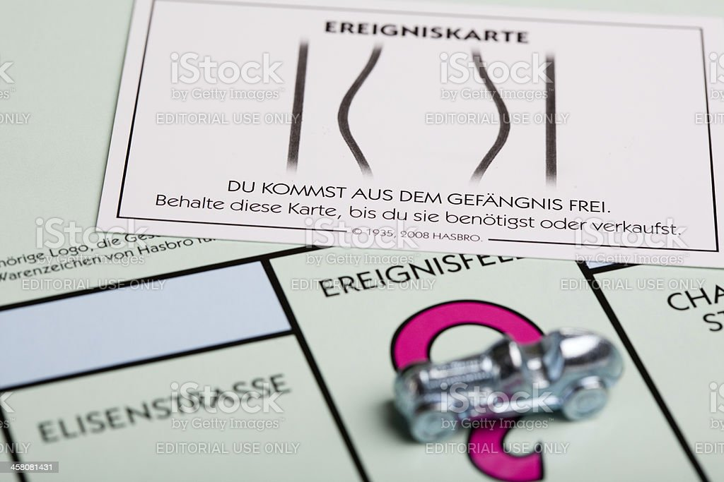 Monopoly board, figure and card stock photo
