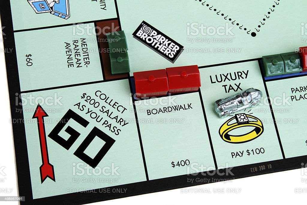 Monopoly board showing Luxury Tax and Go squares stock photo