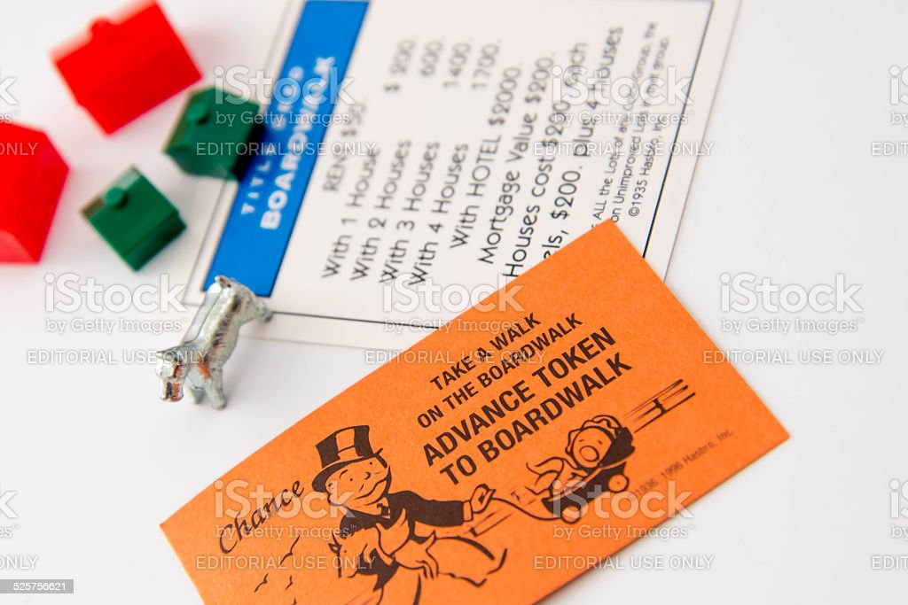 Monopoly - Boardwalk card, dog, hotels and houses stock photo