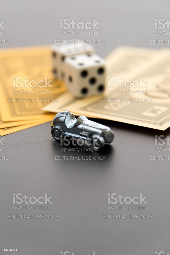 Monopoly car, dice and money stock photo