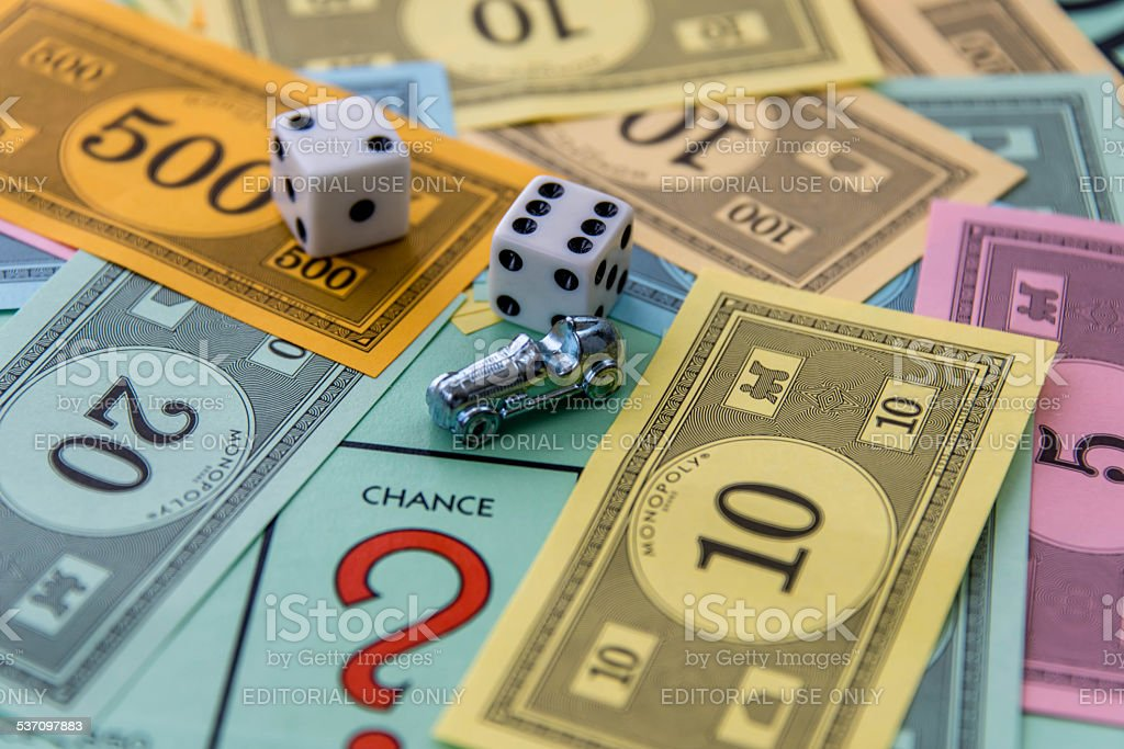Monopoly -  car, dice, money and Chance square stock photo