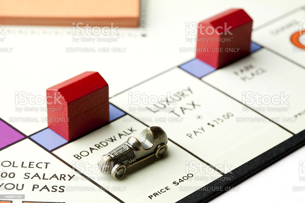 Monopoly Car on Boardwalk Property with Hotel stock photo