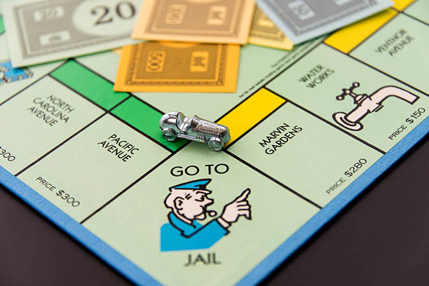 Monopoly - car on Go To Jail square stock photo