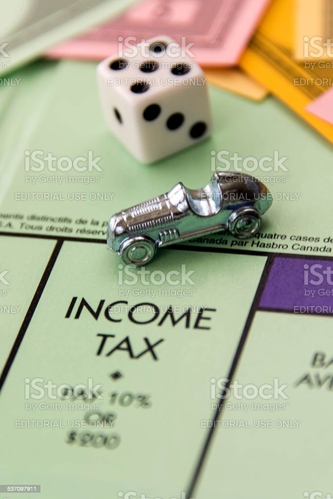 Monopoly - car on Income Tax square stock photo