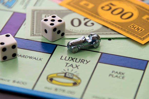 Monopoly - car on Luxury Tax square stock photo