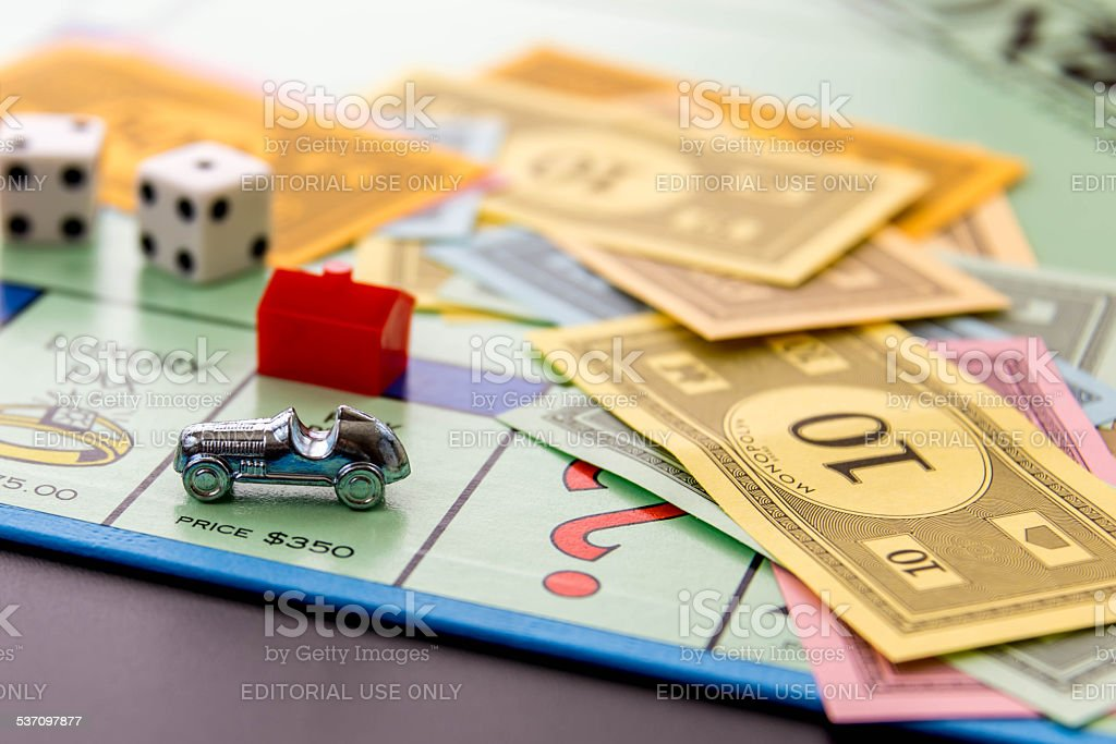 Monopoly - car on Park Place with hotel Houston, TX, USA - February 8, 2015: Monopoly Board Game - car on Park Place with hotel 2015 Stock Photo