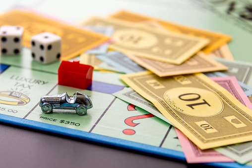 Monopoly Car On Park Place With Hotel Stock Photo - Download Image Now