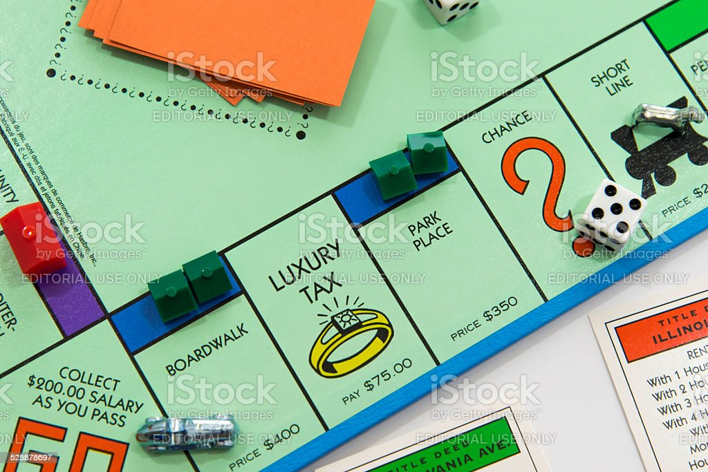 Monopoly game in play - view of car passing Go stock photo