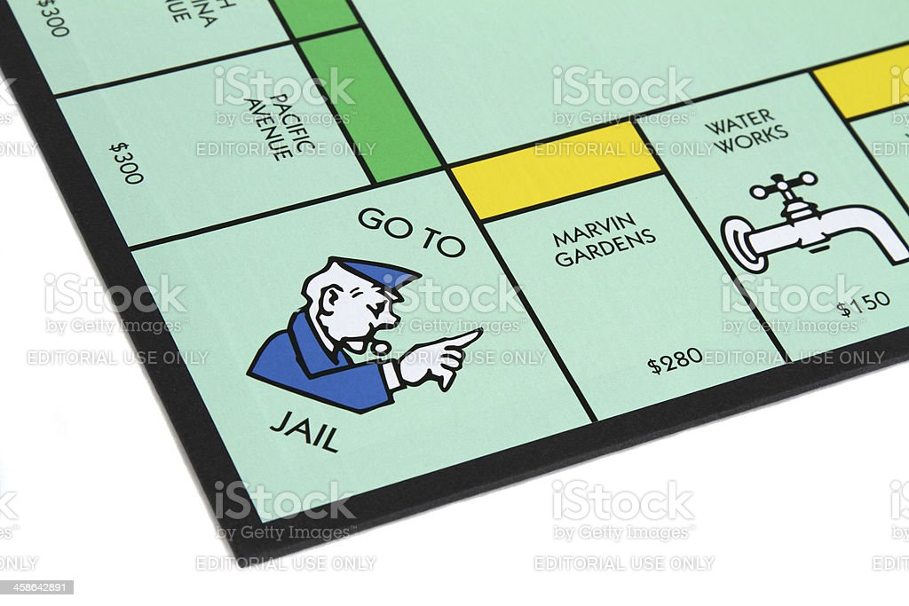 Monopoly game with Go to Jail corner royalty-free stock photo