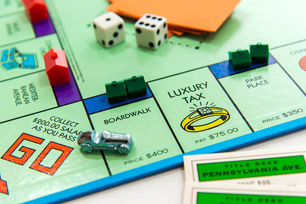 Monopoly in play - view from Go corner with car stock photo