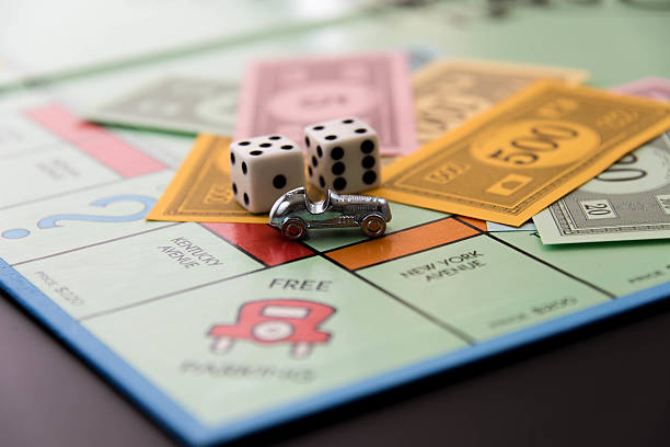 Monopoly - money and car on Free Parking stock photo