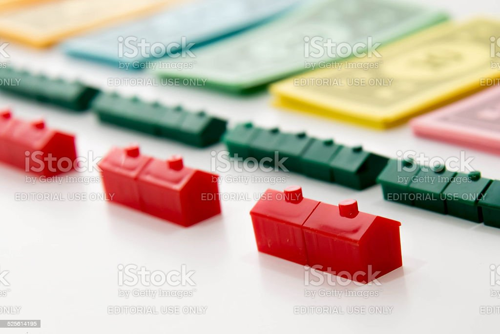 Monopoly - money and pieces lined up stock photo