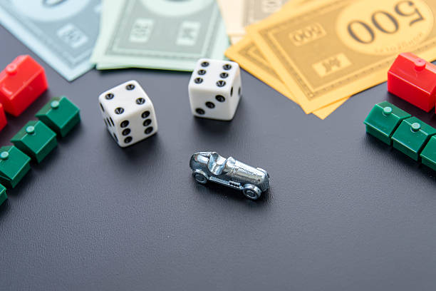 Monopoly - money, car, dice, hotels and houses stock photo