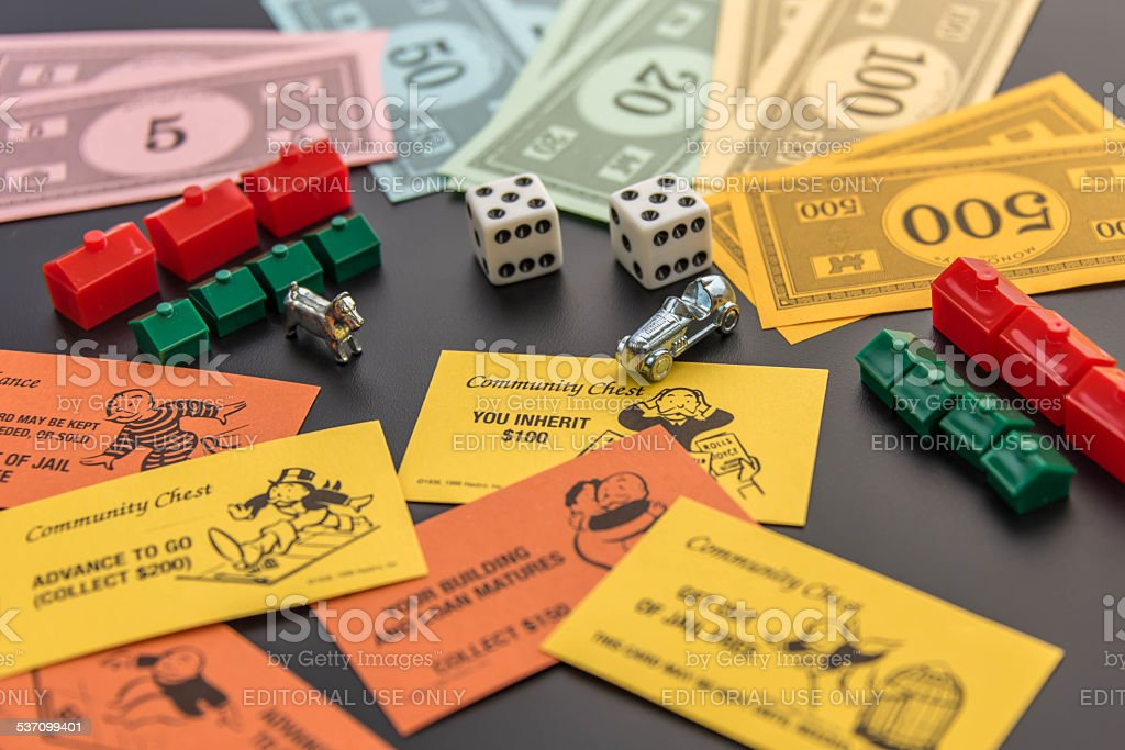 Monopoly - money, playing pieces, dice and cards stock photo