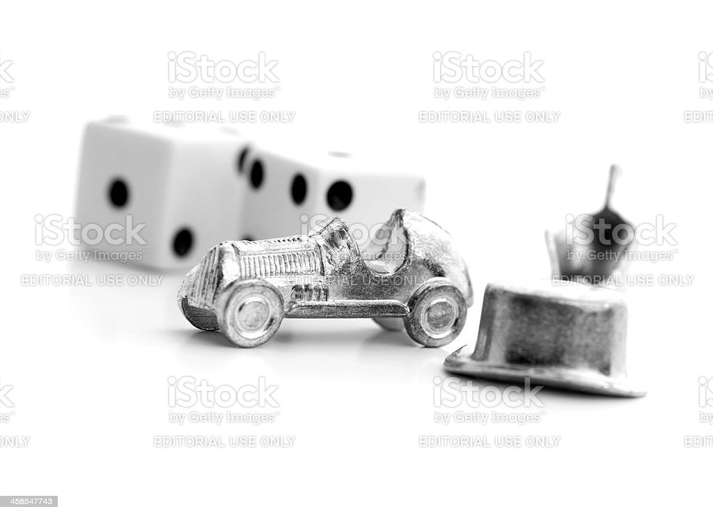 Monopoly pieces and dice on white background stock photo