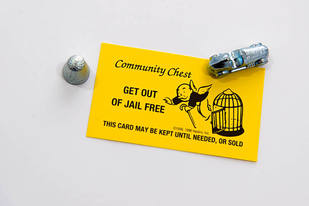 Monopoly pieces and Get Out of Jail Free card stock photo