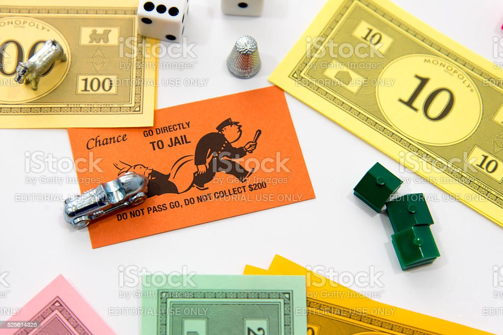Monopoly pieces and Go Directly to Jail card stock photo