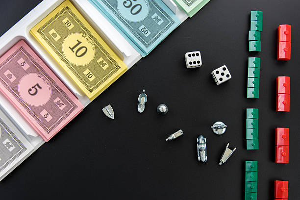 Monopoly - playing pieces, dice and money tray stock photo