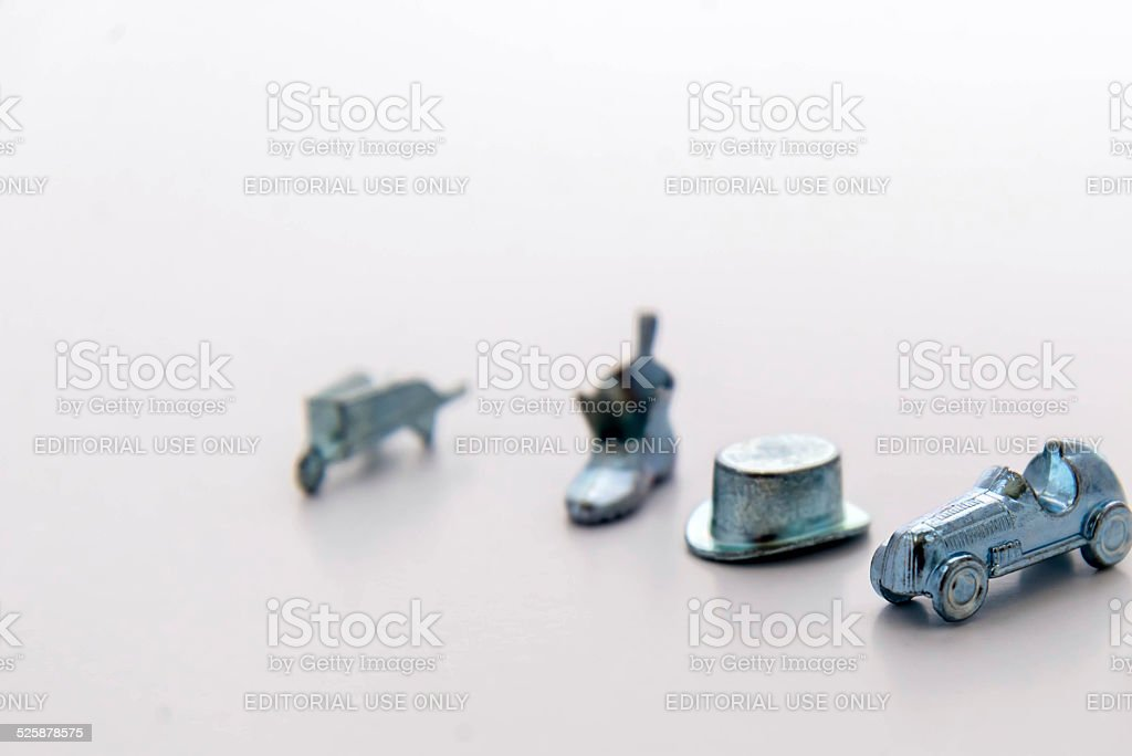 Monopoly playing pieces stock photo