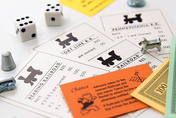 Monopoly - railroad cards, pieces, money and dice stock photo