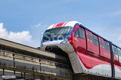 Red Monorail operation over blue sky background located at Kuala Lumpur, Malaysia