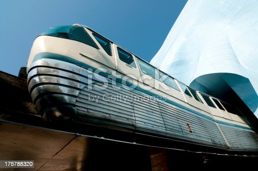 The seattle monorail passing through the experience music project building.