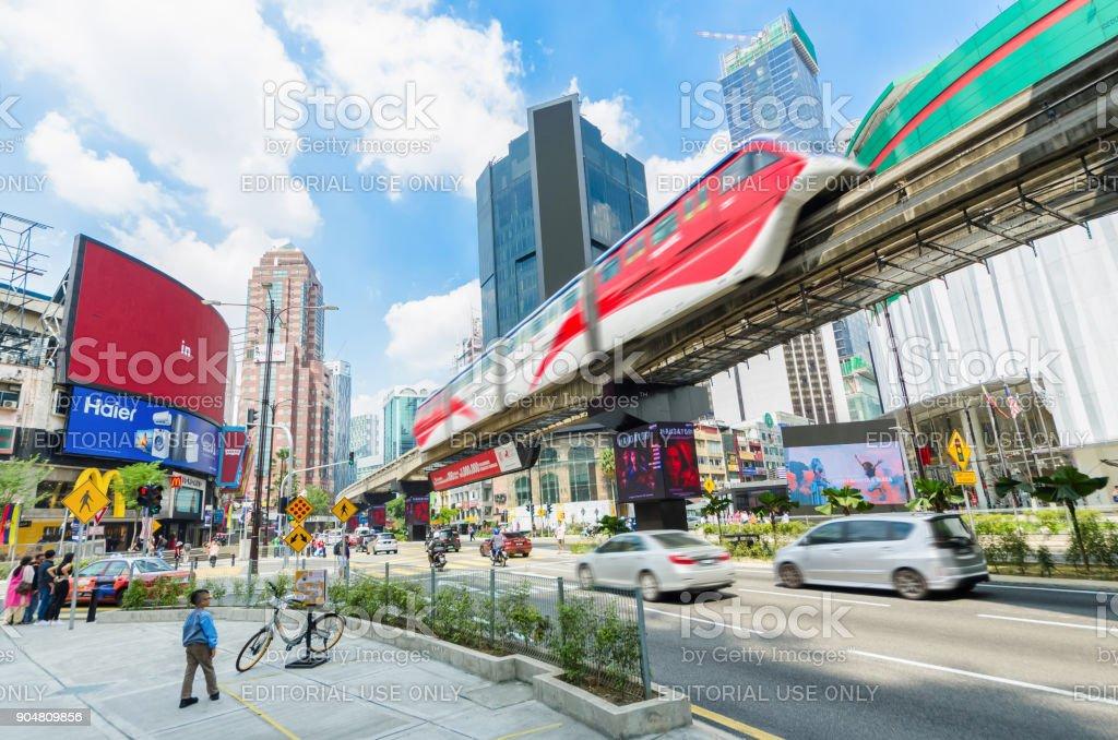 KL Monorail train public transport passing through Bukit Bintang area. People can seen exploring around it. stock photo