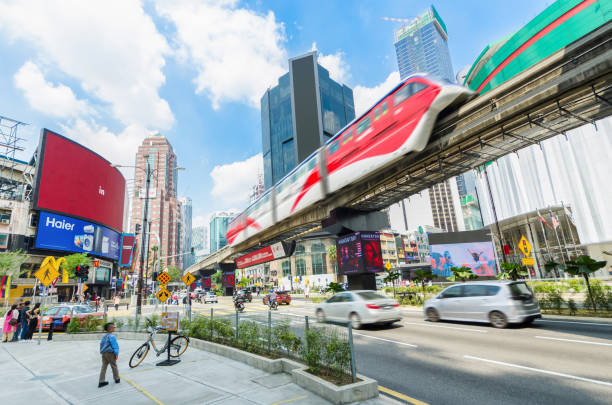 KL Monorail train public transport passing through Bukit Bintang area. People can seen exploring around it. stock photo