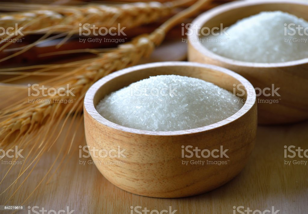 Monosodium Glutamate in wood bowl stock photo