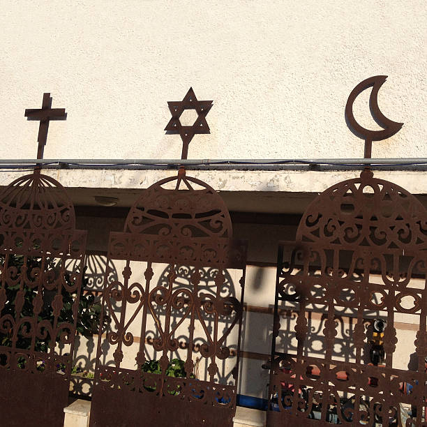Monotheistic religious symbols Symbols of the main monotheistic religions of the world in iron fences in Haifa city, Israel religious symbol stock pictures, royalty-free photos & images