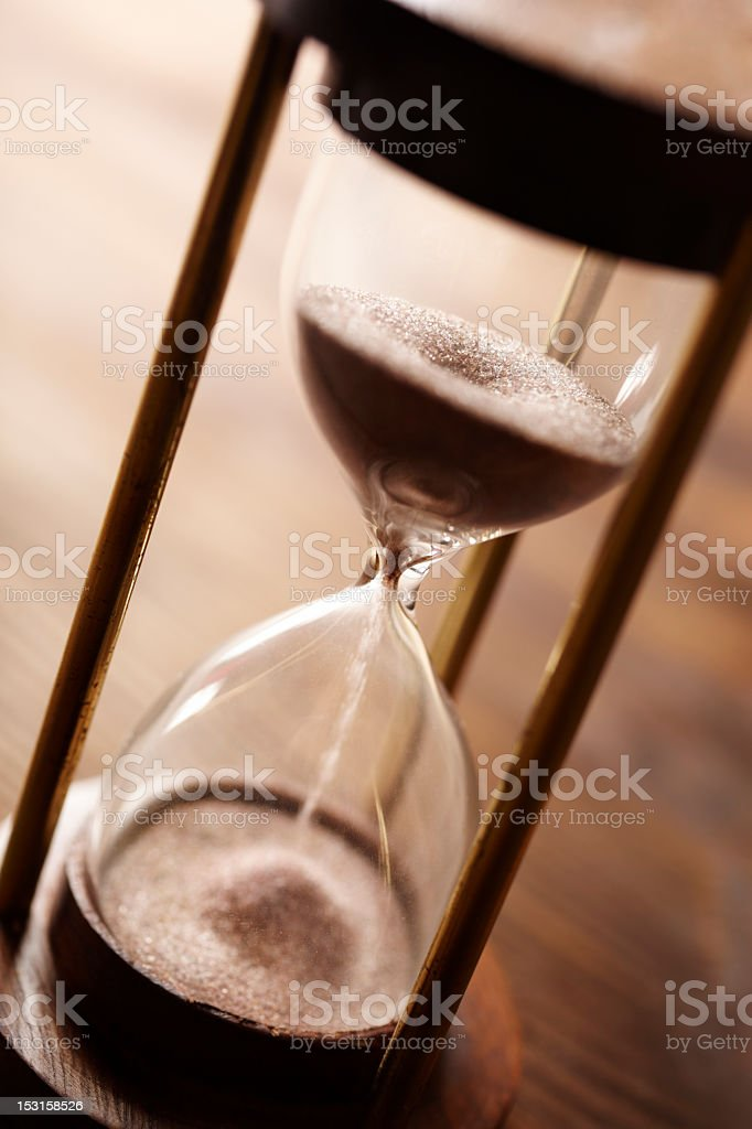 Monotone closeup of an hourglass stock photo