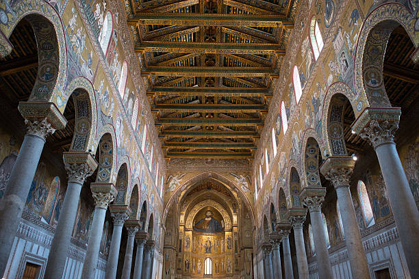 Monreale Cathedral, Blessing Christ in the central apse Apse of the Monreale Cathedral 1174 a.d. (Palermo, Sicily), showing Christ in act of blessing. The cathedral is covered by over 6.000 m2 of mosaic. lancet arch stock pictures, royalty-free photos & images