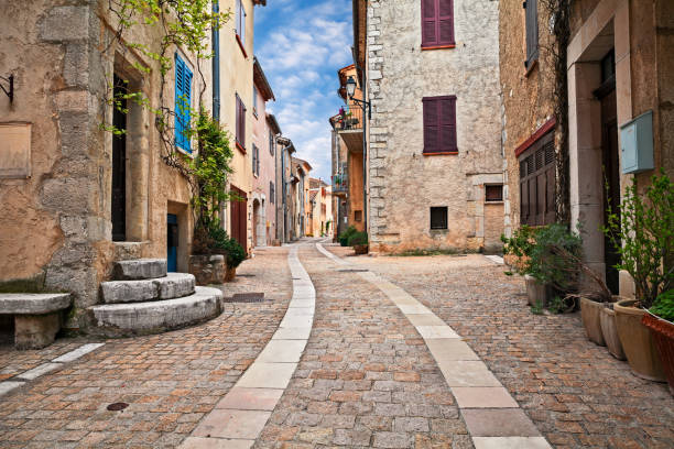 Mons, Var, Provence, France: cityscape of the ancient village Mons, Var, Provence, France: picturesque cityscape of the ancient village perched on the top of a mountain narrow stock pictures, royalty-free photos & images