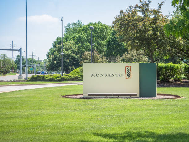 Monsanto corporate headquarters sign SAINT LOUIS, UNITED STATES - May 16, 2018: Monsanto sign at entrance to corporate headquarters at Creve Coeur campus before Bayer takeover buyout herding stock pictures, royalty-free photos & images