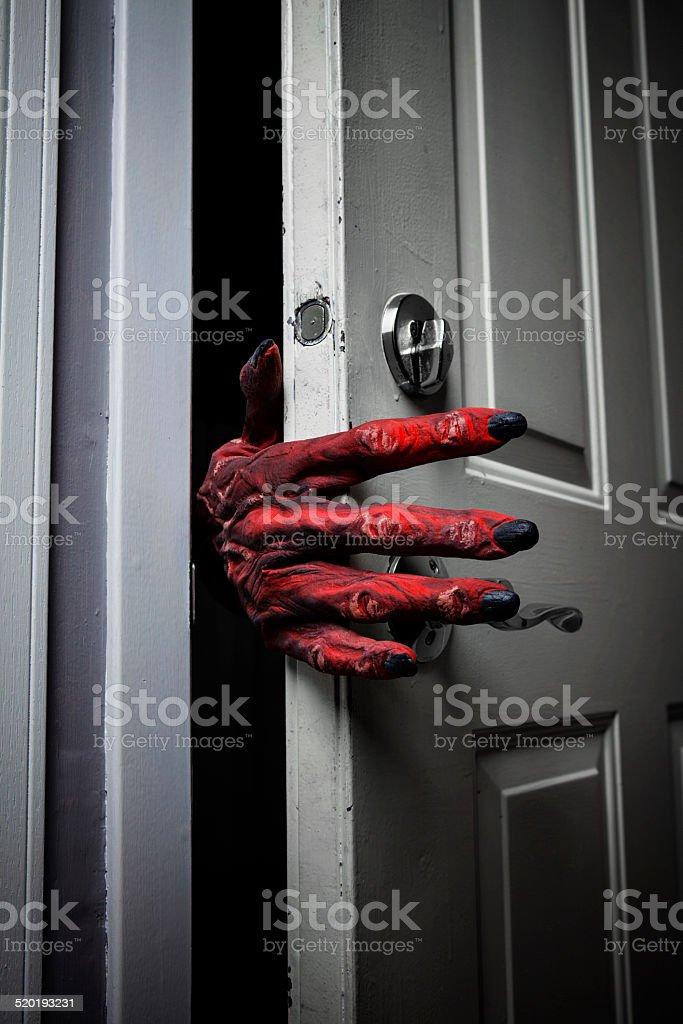 Monster's Hand Comming in the Door stock photo