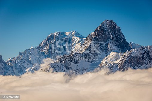 Mont Blanc and Grandes Jorasses above the winter clouds in the valley.